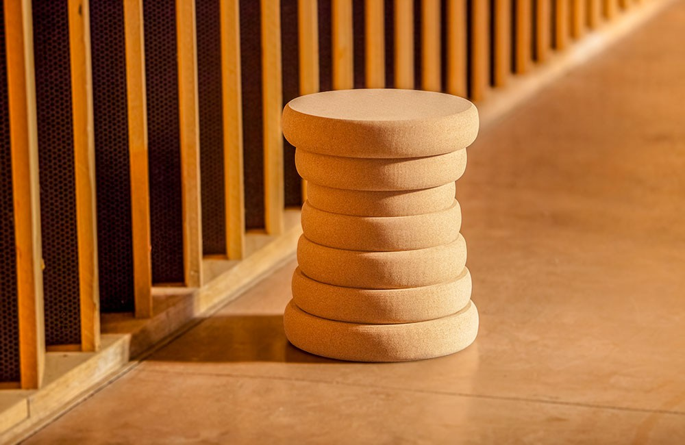 It looks like a wood carving which make it a beautiful and modern stool